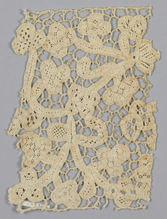 """Insertion fragment showing a floral pattern with birds in the style of """"mezzo punto"""" lace – a combination of bobbin made tape with needlework filling stitches."""