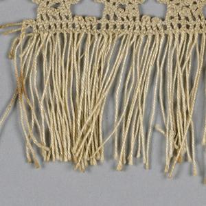 Fringe with narrow heading of braided lace.