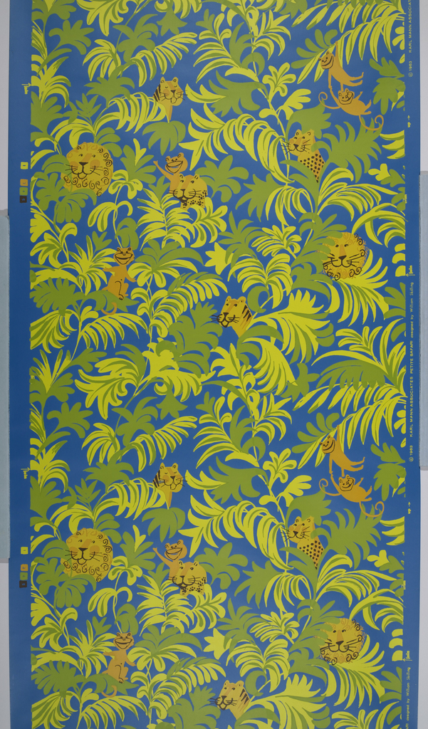 Children's wallpaper. Contains cartoon-like jungle animals, including lion, tiger, leopard and monkeys interspersed with jungle foliage. The monkeys are swinging from trees. Printed in ocher, green and black on a deep blue ground.