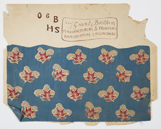 Fabric pasted to cardboard containing a drawing of the mark. The fabric has a design of floral sprays in read, grey and natural on a blue background.
