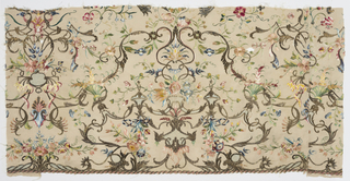 Symmetrical Rococo design of silver gilt arabesques and cartouches, combined with naturalistic flowers in polychrome silks, on ivory silk ground.