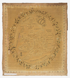 Oval map of England and Wales with each of the countries indicated. A floral of curving vines tied with a ribbon bow at the edge. The embroidery has all been done over a printed outline. The fabric is nailed to a wooden frame.