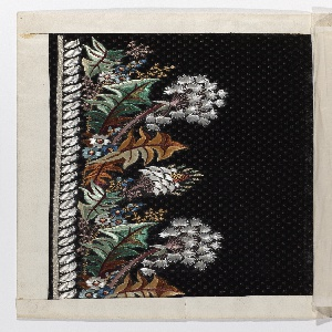Dark purple velvet with minute square dot pattern; embroidered border design in white and brilliant colored silks. Pattern of fantastic foliage and flowers.