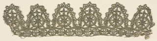 Band of deep pointed lace with narrow border at top. Rosette within circle on each point.