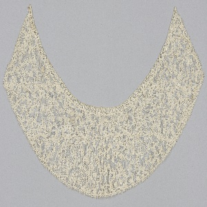 Collar formed from pieces of 17th century Milanese lace joined by needlework.