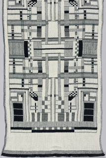 Creped cotton scarf with an abstract geometric design resembling a diagram of a computer chip. In black and white; one side is the negative image of the other.