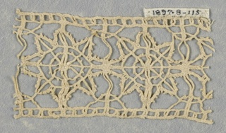 Fragment of braid-like bobbin lace. Insertion with eight-pointed star motif.