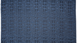 Drapery sheer in an irregular checkerboard design of sheer and opaque rectangles, in midnight blue.