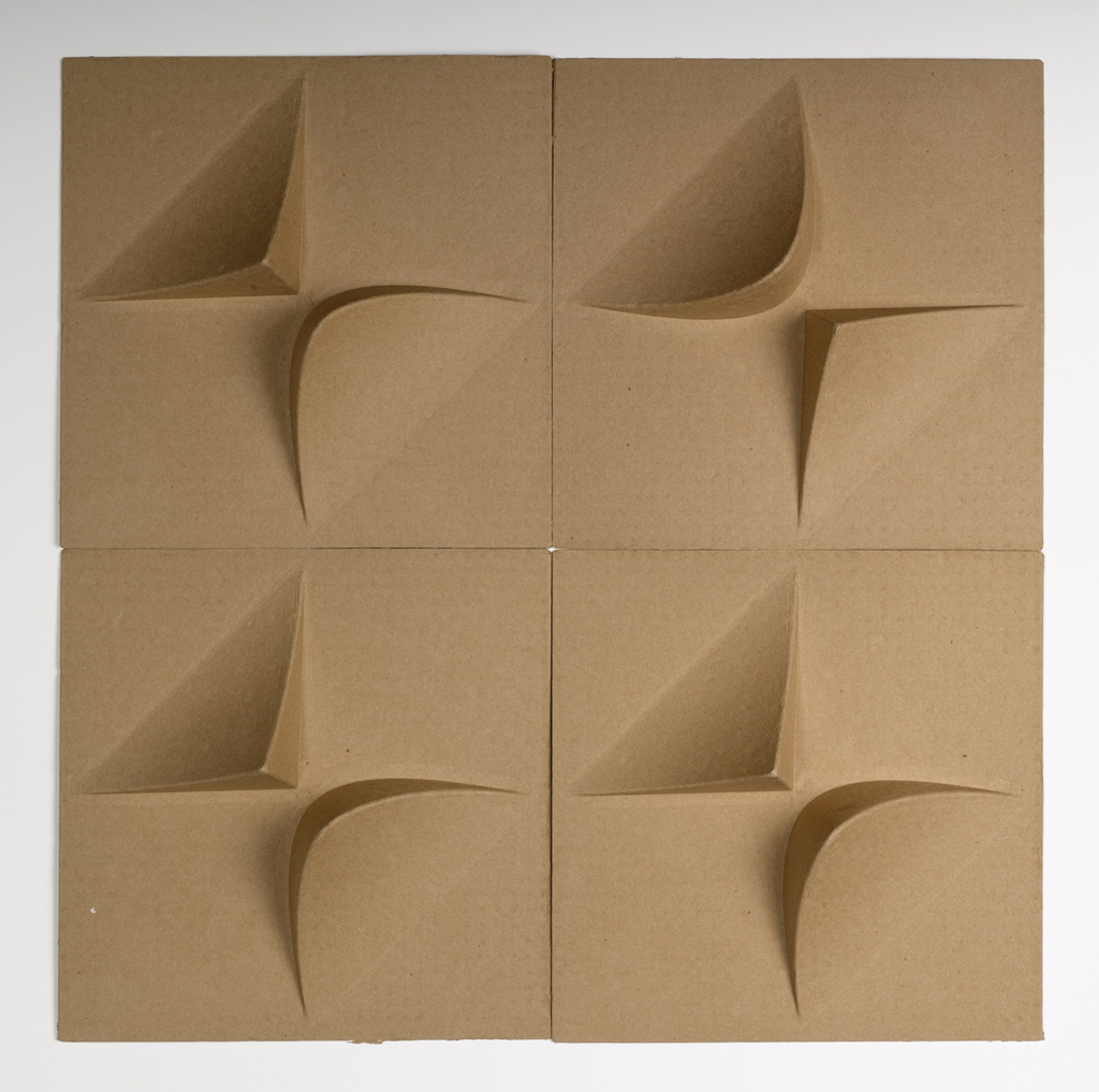 Square tiles embossed to a depth of 2.5 inches.  The embossing includes 2 protrusions in alternate corners, one triangular and one rounded.   The tiles are a natural brown in color and can be installed in many different patterns on the wall or ceiling.