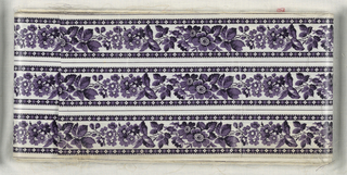 Three uncut bands of floral border in purple and black on white.