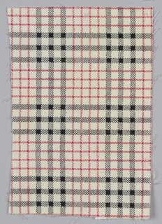 Printed cotton with red and black plaid on a white ground.