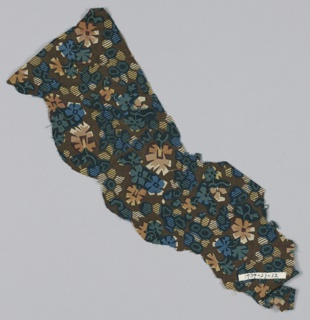 Fragment with a pattern of geometric forms and flowers in dark blue, red and yellow on a brown ground.