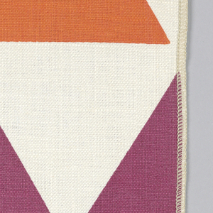 Rows of triangles printed in pink, orange and purple on white. Serged on two sides, cut on two sides.