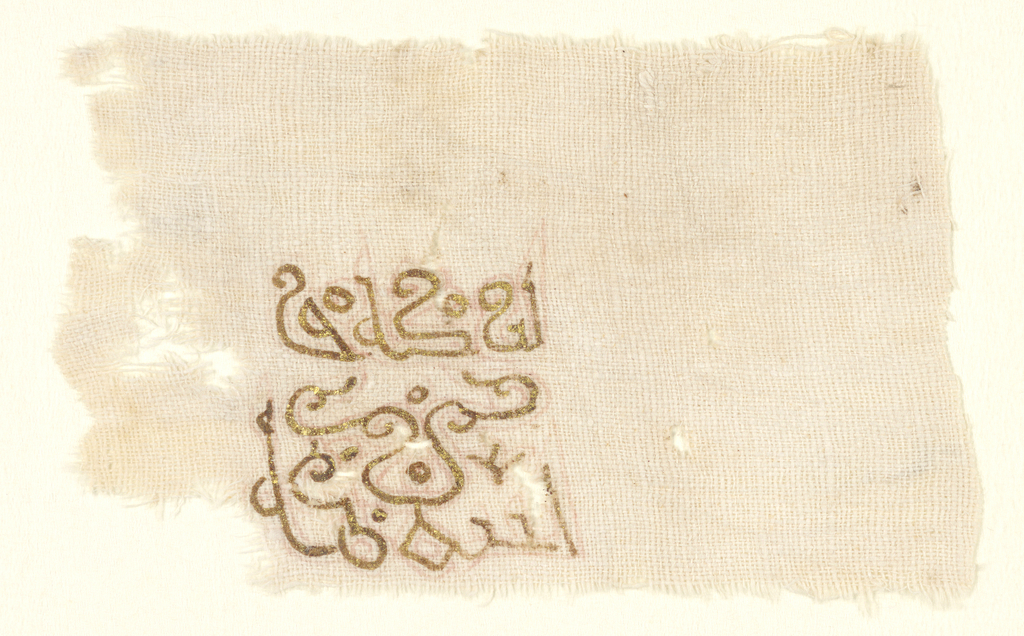 Small rectangle of undyed cotton cloth stamped in red (now very faint) with square formed by two lines of outlined characters of decorated Kufic; painted over (at a later date?) with more flowing version of the same characters in dark brown adhesive substance, to much of which gold leaf still sticks.