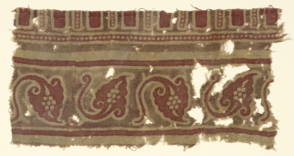 Unbleached cotton, border design in red and dull brown (possibly faded purple).  Detached pattern: pointed leaf with actively curved stem alternating with leaf in upside down position, interstices in brown.  Above and below, plain bands of red: at top, incomplete pattern of oblongs with pearled details.
