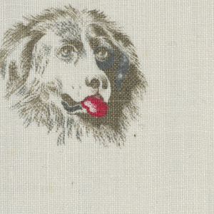 Woven cotton textile printed in brown and red on white ground showing dog heads with protruding tongues.