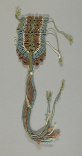Cord in green, brown, white and blue, knotted into an oval shaped ornament, ending in  tassel with fringed ends. All four ornaments are alike, except that two have long tassels and two short tassels.