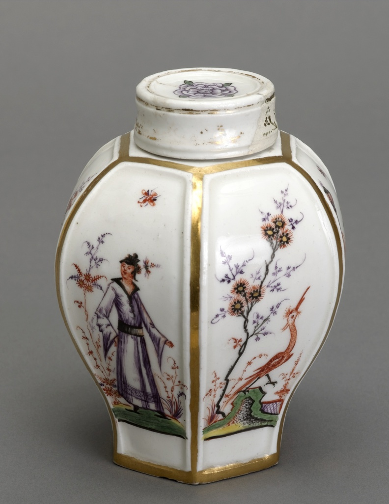 A white tea caddy with a bulbus shoulder and simple cup-like lid. Tea caddy outlined in gilt with painted birds, flowers and figure on the sides.