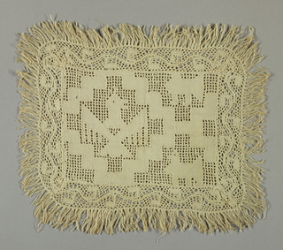 Small cover with bobbin lace edging and fringe has an eagle inside a stepped diamond motif.
