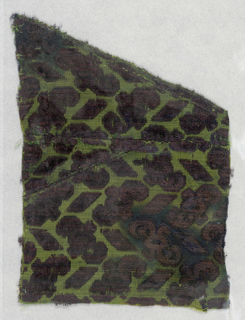 Fragment of deep purple cut and uncut velvet on chartreuse green silk ground. Design of tiny conventionalized branch with leaf at either end curving in opposite directions, alternating with tiny rhomboids. Alternate horizontal rows turn right and left.