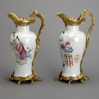 """Baluster-shaped vases with ormolu mounts in shape of ewer. Interior scene with figures, animals, porcelains and flowers in overglaze enamel in """"famille rose"""" colors."""