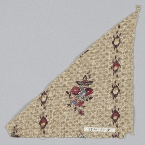 Triangular-shaped fragment with alternating vertical columns of floral clusters and circular shapes made from short vertical dashes. Ground is light brown vertical dashes and dots that form a diaper pattern.