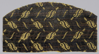 Dark purplish-brown cut and uncut velvet in stylized leaf pattern against yellow ochre ground.