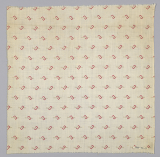 """White fabric printed in a design showing a red rectangle with the word """"Centennial"""" in brown."""