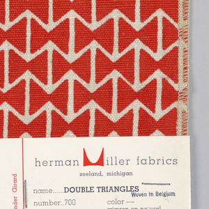 Rows of two triangles facing each other forming a bow tie shape, with alternating rows of off-set repeat. Printed in red on natural.