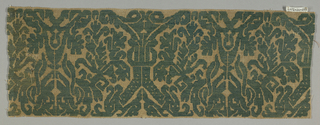 Fragment of a border with a symmetrical scrolling vine pattern in green on gauze weave.