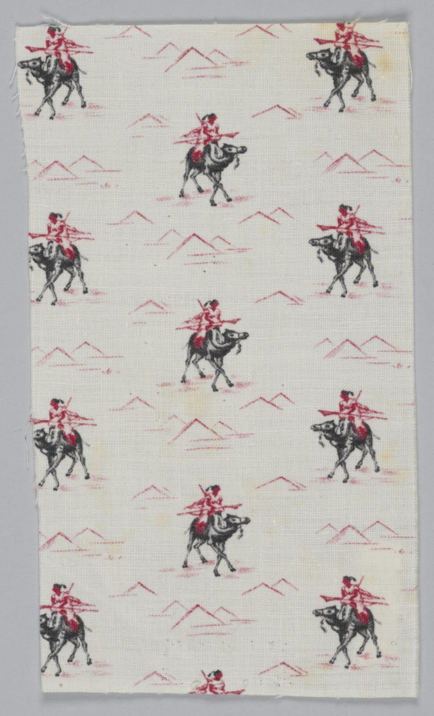 Sample showing a camel with a rider and pyramids. In red and black on a white ground.
