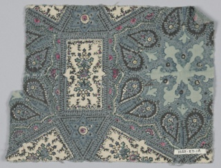 Fragment inspired by Near Eastern design has six-pointed stars and other compartments with secondary ornament in blue, green and pink.