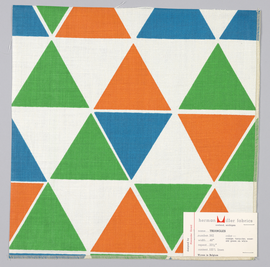 Rows of triangles printed in blue, green and orange on white. Serged on 2 sides, cut on 2 sides.
