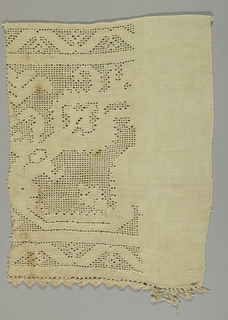 Piece of linen ornamented by drawn work at one side. One border of fringe.