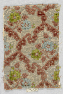 Pattern of floral sprigs in green, blue and brown pile in grid of brown pile on a silver faced white silk ground.