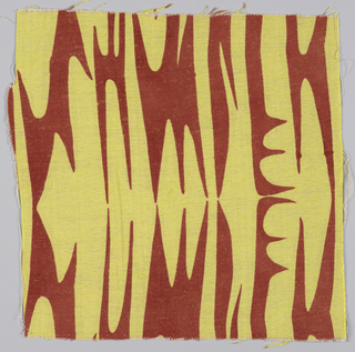 Sample of woven fabric with yellow abstract curvilinear shapes on a rust ground.