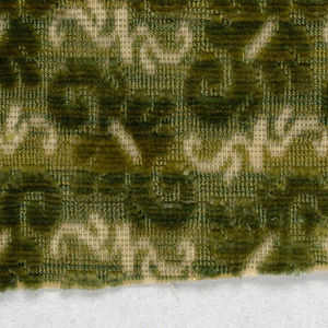 Small pattern of diagonal shapes in green on cream.