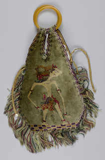 Velvet bag ornamented with printed wayang puppets on both front and back of bag, in red, green, purple, and light brown. Pair of handles made of amber. Has inner drawstring pouch made of gold-colored silk with silk strings and mother of pearl drops at ends. Silk lined. Fringed along bottom and sides (up to opening).