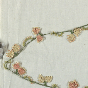 Edging of decorative shapes in green, rose and white.