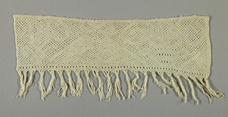 These fringes were probably cut from towels and were originally the ornamentation made by weaving and braiding the warp ends.  A lozenge design with crosses and quatrefoils in openwork.
