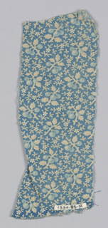 Fragment with a blue ground and tiny sprigs and blossoms in white and light blue.