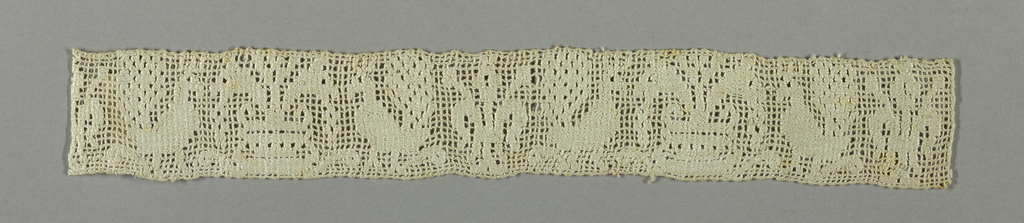 Narrow band with a pattern of white roosters and symmetrical plants on white gauze weave.