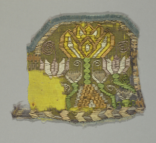 Border fragment with multi-colored silk embroidery on velvet linen gauze in a symmetrical floral pattern.