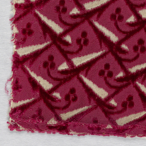 Fragment of red cut and uncut velvet on white ground. Design of diagonally running irregular areas in uncut pile connected by lines of cut pile with branches of tiny three-petal blossoms that curve over solid areas.