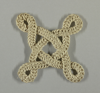 Interlaced loops with twisted ends mounted on black velvet with the rest of 1947-23-1/32. Four-pointed star.