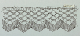 Continuous geometric interlaced band with zigzag edge.