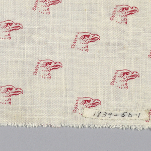 White fabric printed in a design showing red eagle heads in diagonal lines.