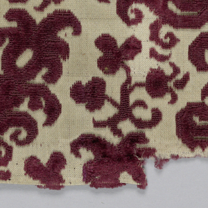 One end of a stole of deep red cut and uncut velvet on white satin ground. Design of small flowering branches alternate horizontal rows turning left and right.