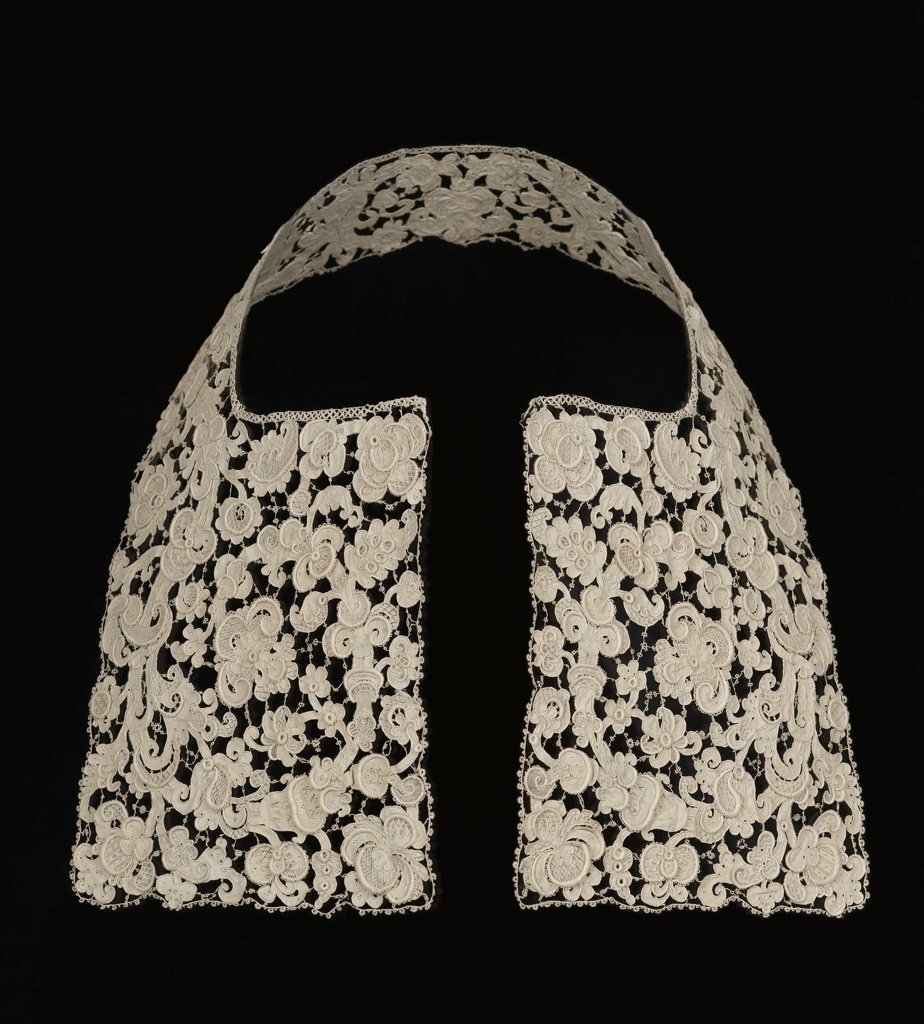 A deep, squared man's collar in Venetian-style needle lace, with large, baroque floral motifs and foliated scrolls with thick raised edges and finely worked connecting bars.
