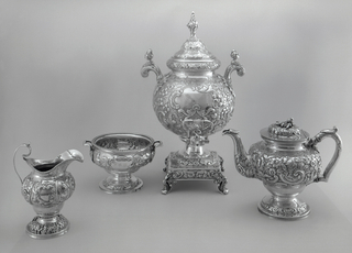 Part of repoussé and engraved tea set consisting of teapot (a), urn with lid (b,e), creamer (c), sugar bowl (d).